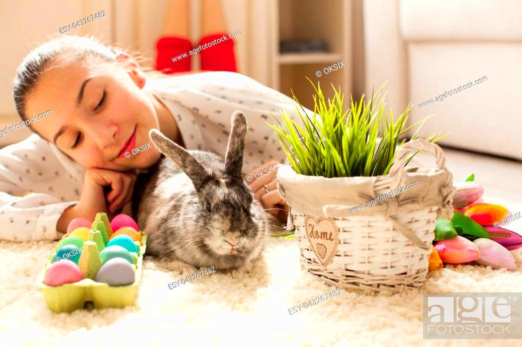 Stock Photo: Easter rabbit in home with eggs and green grass.