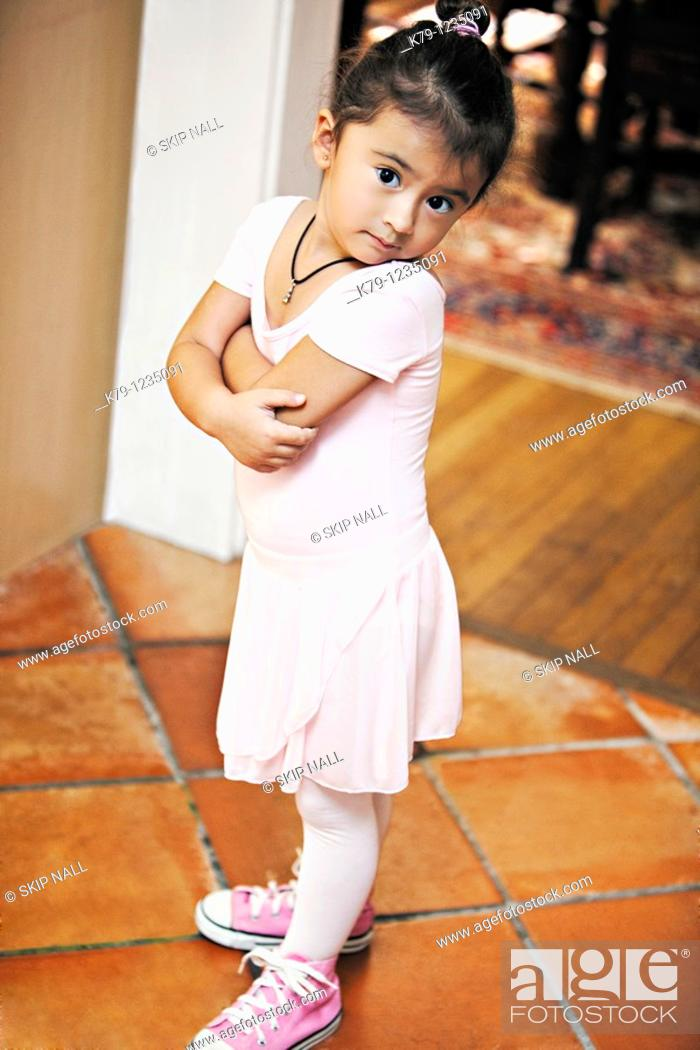 Stock Photo: Little girl in ballet costume looking at camera.