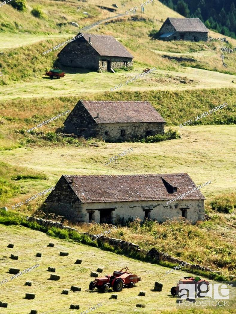 Stock Photo: Farm works in meadow and 'bordas' (isolated rural house), Viados, Posets-Maladeta Natural Park, Pyrenees Mountains. Aragon, Spain.
