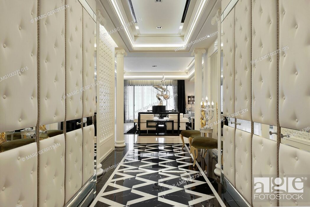 Stock Photo: Hallway of elegant home with black and white marble flooring.