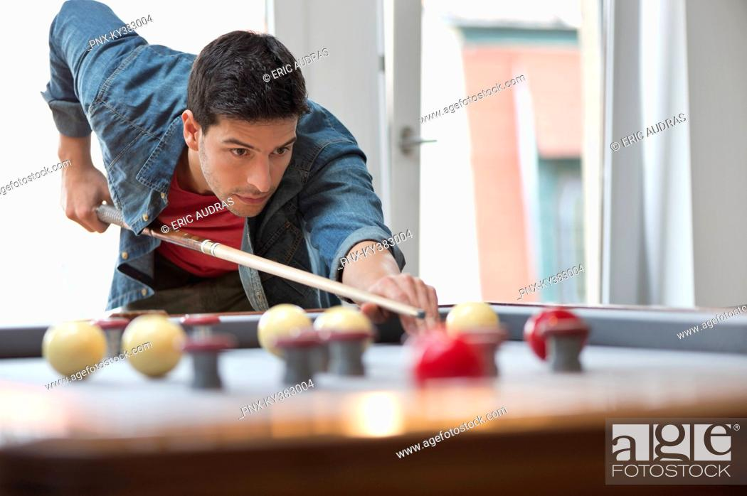 Stock Photo: Man playing snooker.