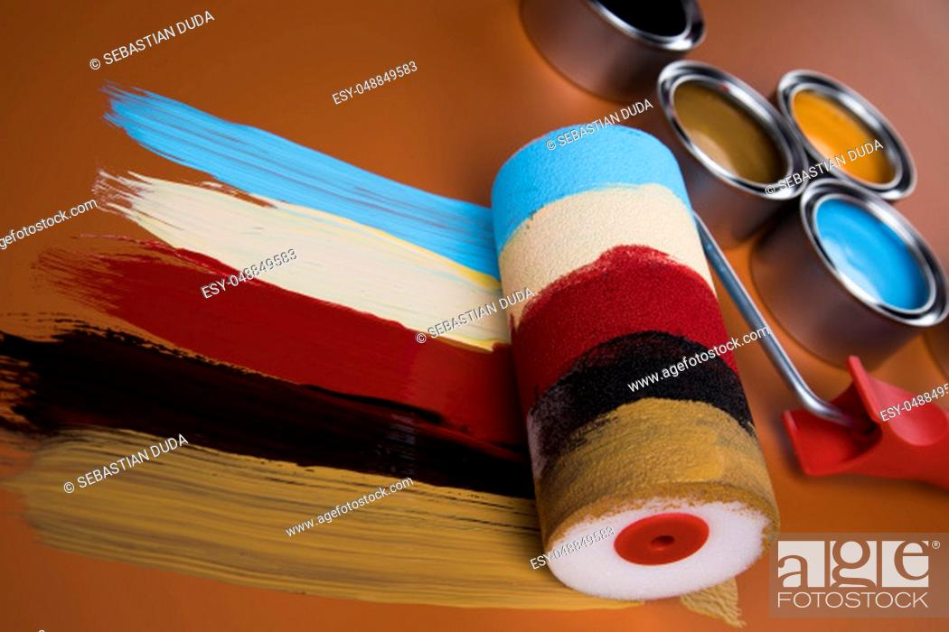Stock Photo: Metal tin cans with color paint and paintbrush.