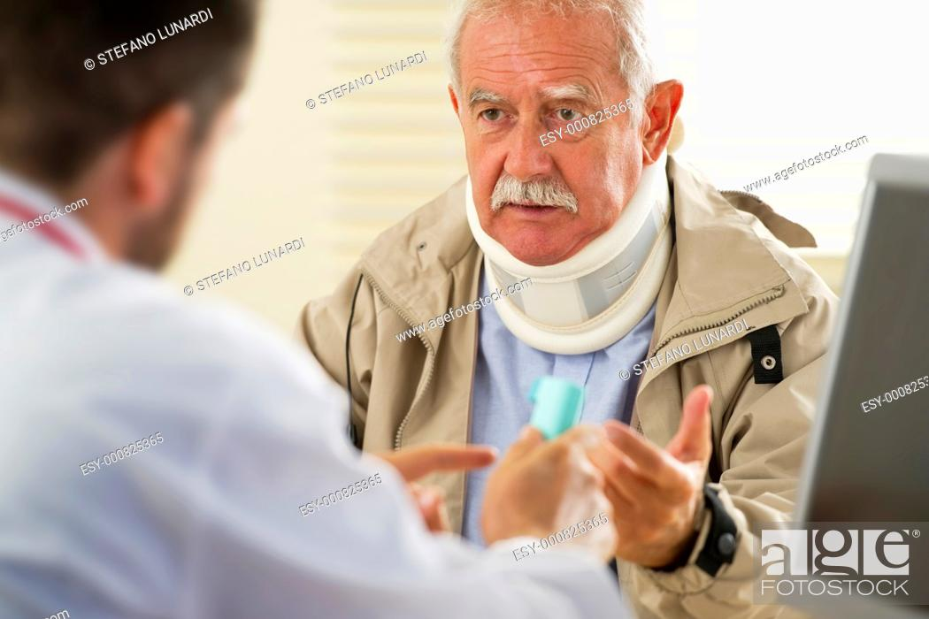 Stock Photo: Senior man at the doctor, selective focus.