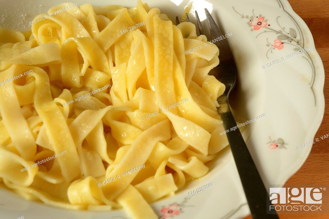 Stock Photo: Plate of tagliatelle pasta lying on table.