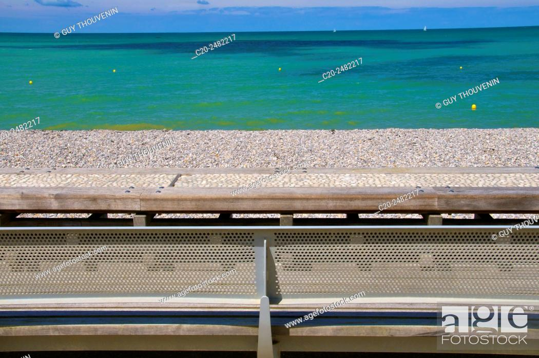 Stock Photo: Pebbled path and wood benches along the beach and sea, Normandy, France.