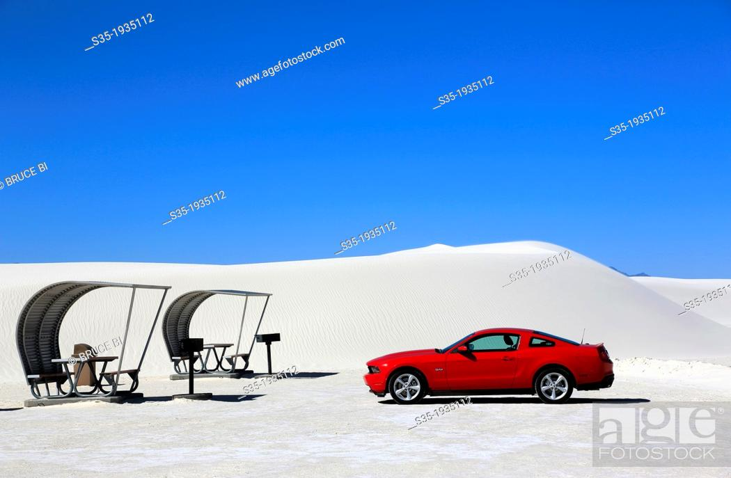 Stock Photo: A red car with shaded picnic tables in the picnic area in White Sands National Monument. Alamogordo. New Mexico. USA.