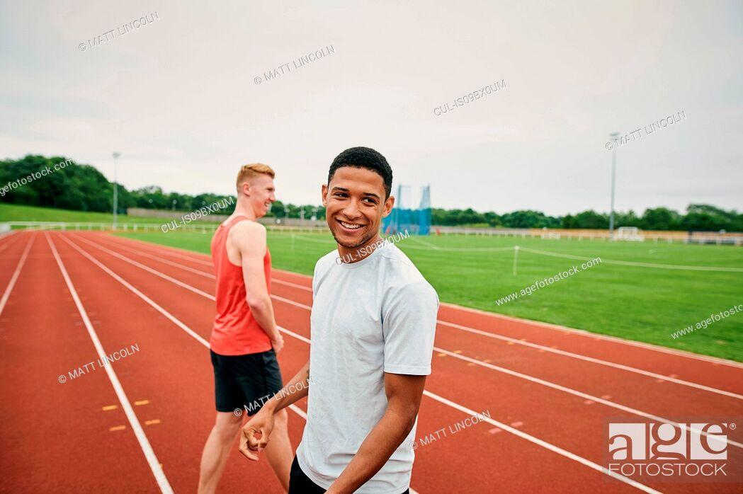Stock Photo: Runners on running track.