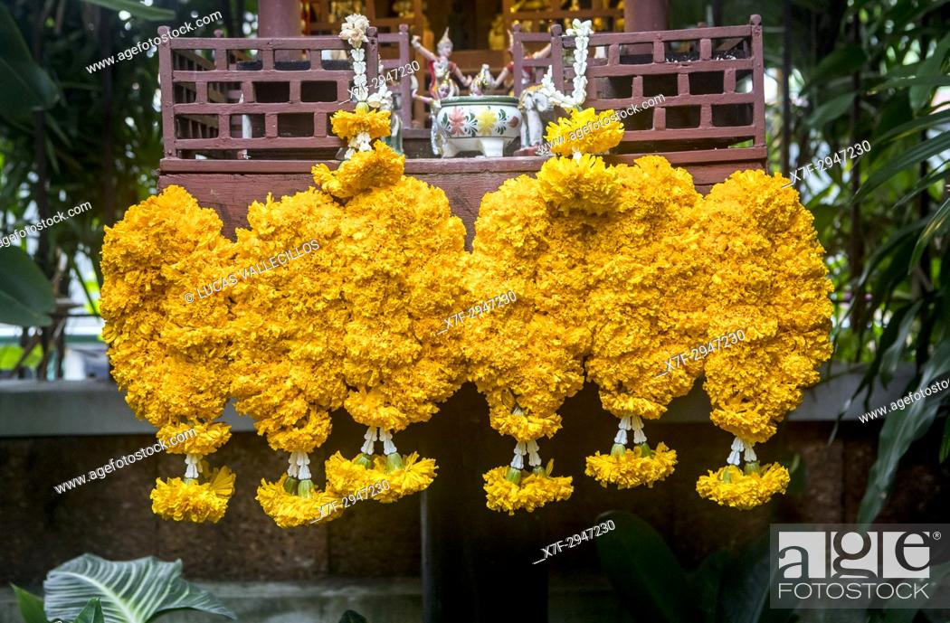 Stock Photo: Flower offering at the temple of Jim Thompson House and museum, Bangkok, Thailand.
