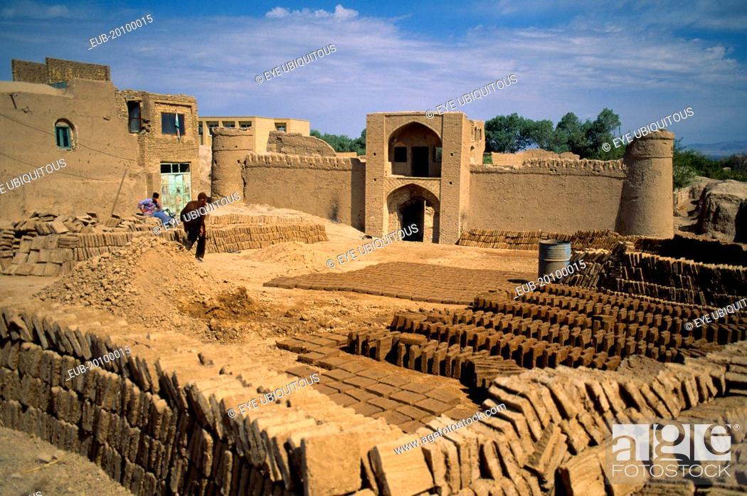 Stock Photo: Mud brick making in ancient mud city.