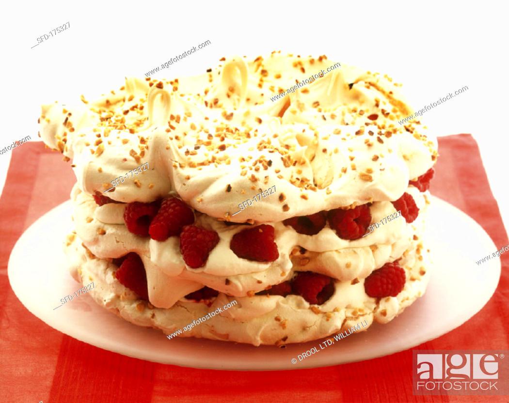 Stock Photo: Raspberry and nut meringue gateau.