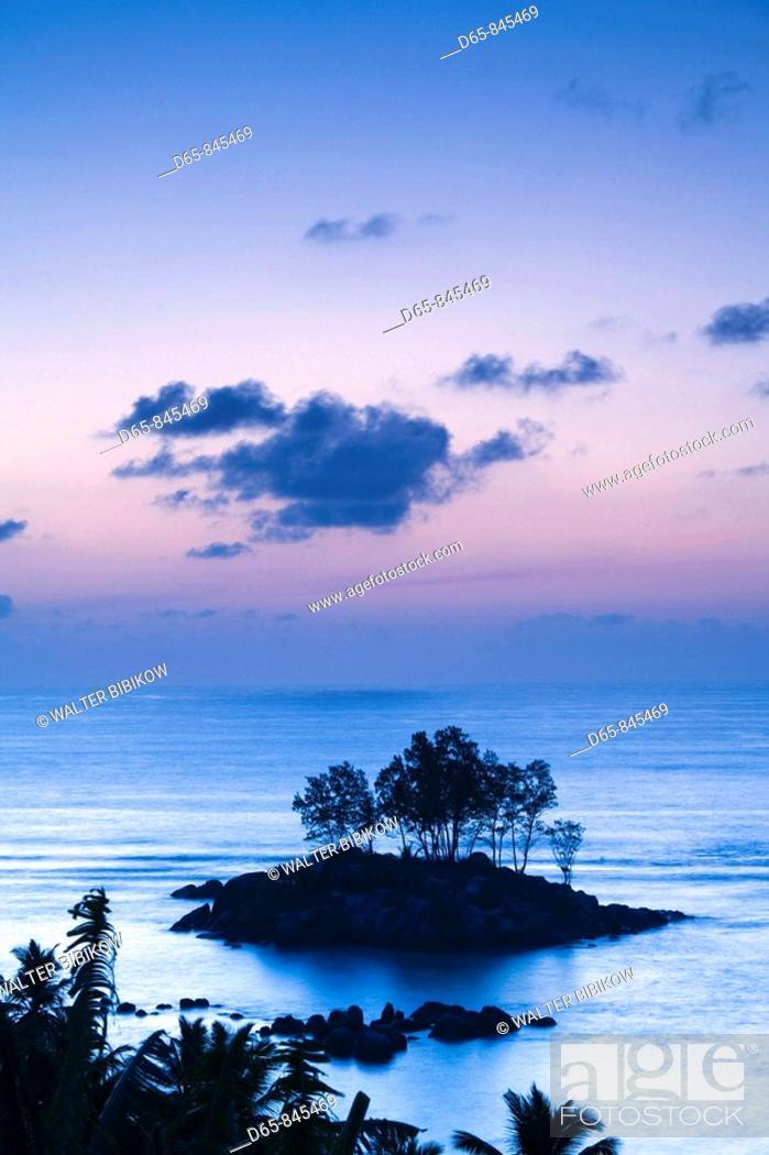 Stock Photo: Sunrise, Fairyland Beach, Mahe island, Seychelles.