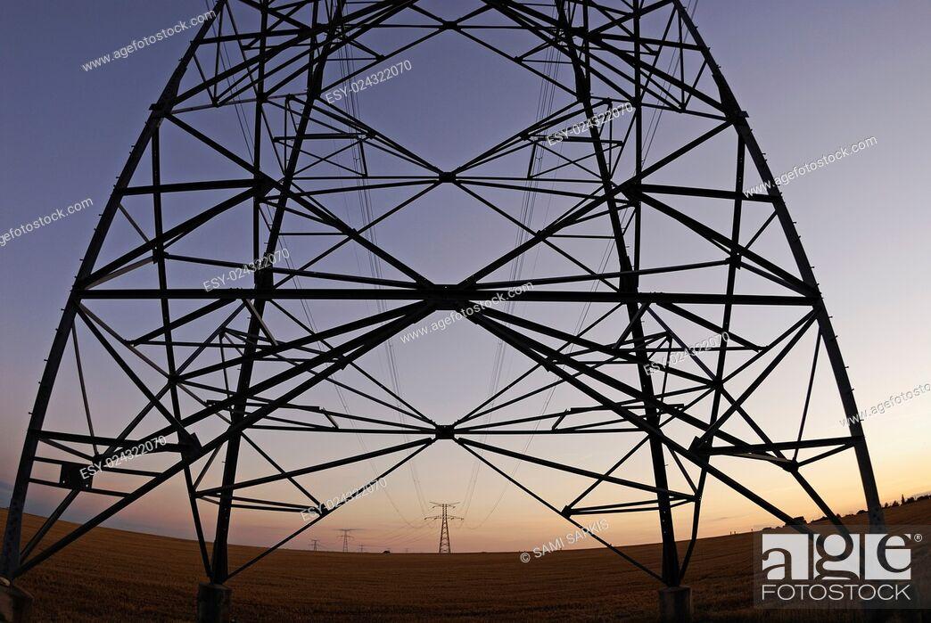 Stock Photo: Electricity pylons at sunset, Lion en Beauce, France (fisheye lens).