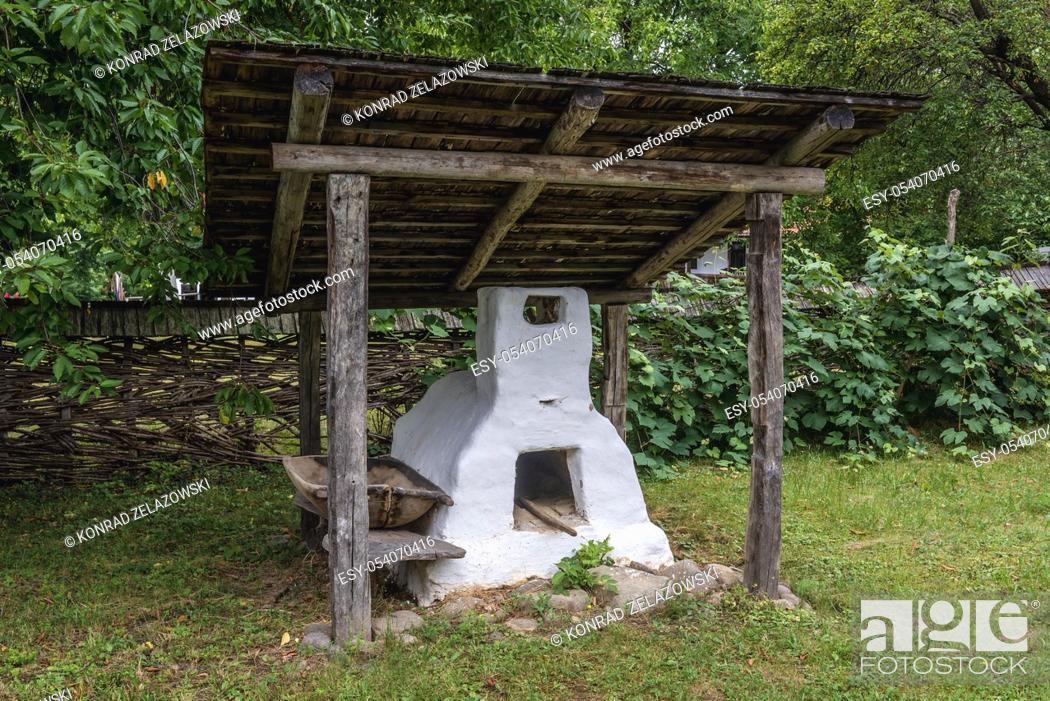 Stock Photo: Old clay stove in Oas Village Museum located in Negresti-Oas town in the county of Satu Mare in northwestern Romania.