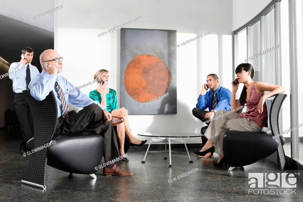 Stock Photo: Businessmen and businesswomen talking on mobile phones.