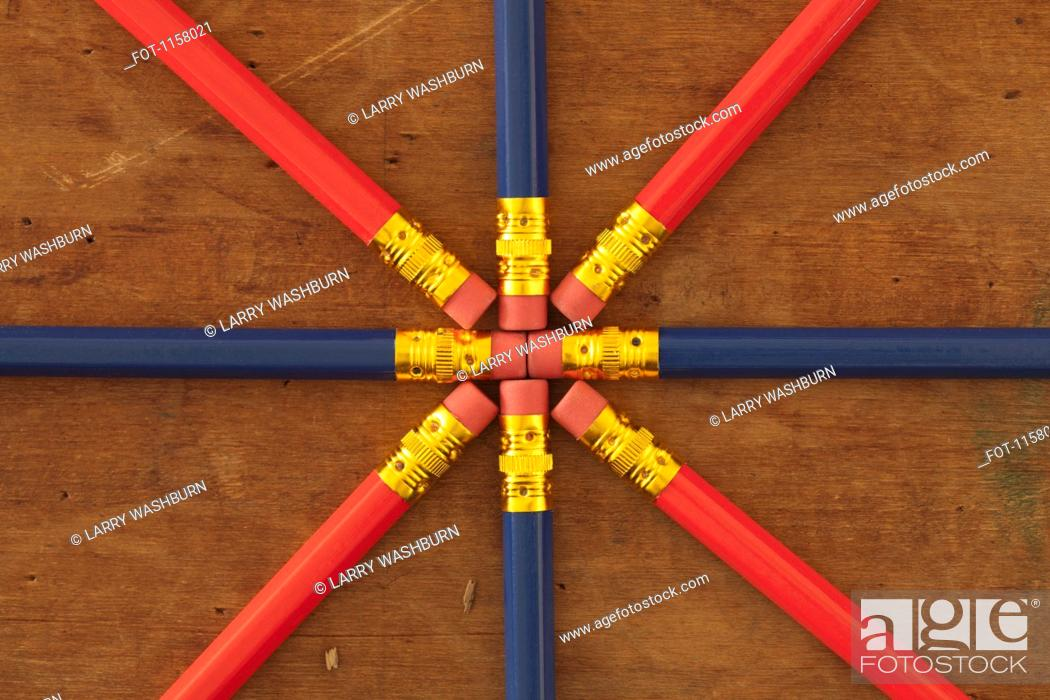 Stock Photo: The eraser end of pencils arranged in a star shaped pattern.
