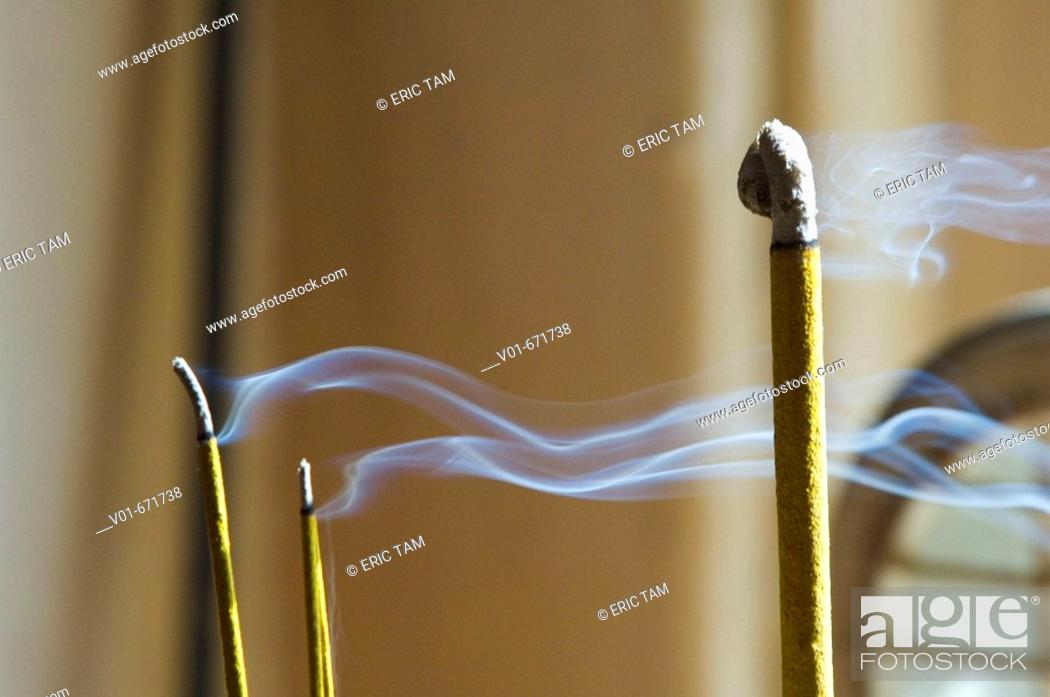 Stock Photo: Smoke rising from incense.