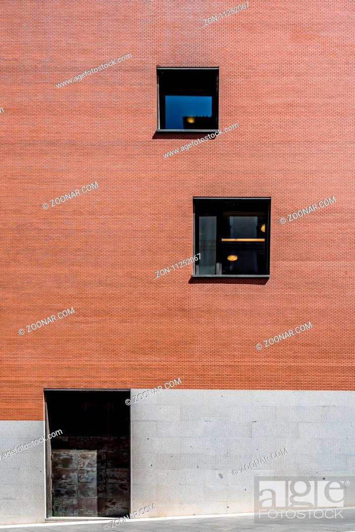 Stock Photo: Modern architecture door and windows in a facade made of stone, brick and steel. Abstract design.