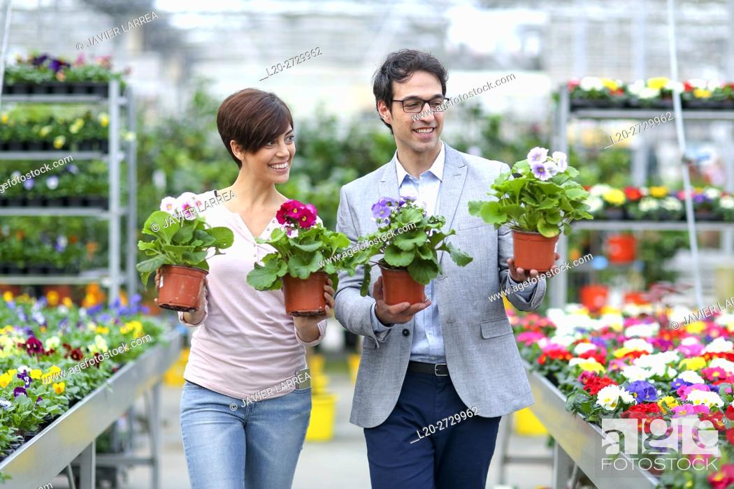 Stock Photo: Couple buying flowers, garden center.