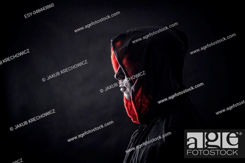 Stock Photo: Hooded man in the dark.