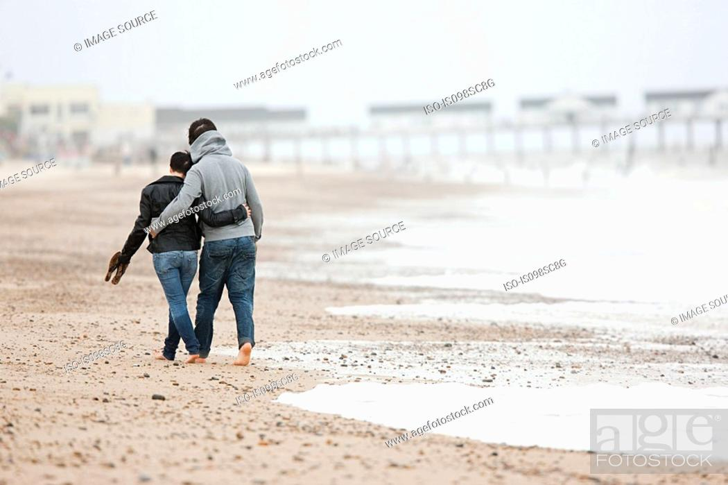Stock Photo: Couple walking by the sea.