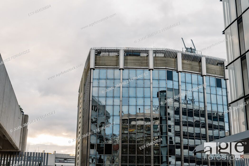 Stock Photo: Low angle view of modern architecture office buildings in Castellana Avenue in Madrid against cloudy day.
