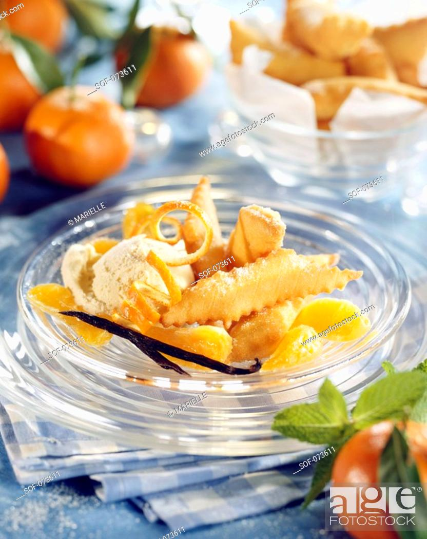 Stock Photo: fritters and candied clementines.