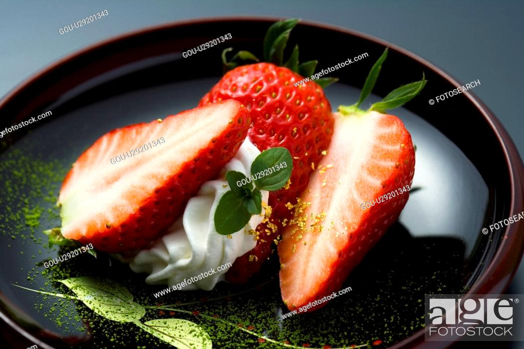 Stock Photo: Sliced strawberries on a plate, high angle view, close up, black background, Japan.