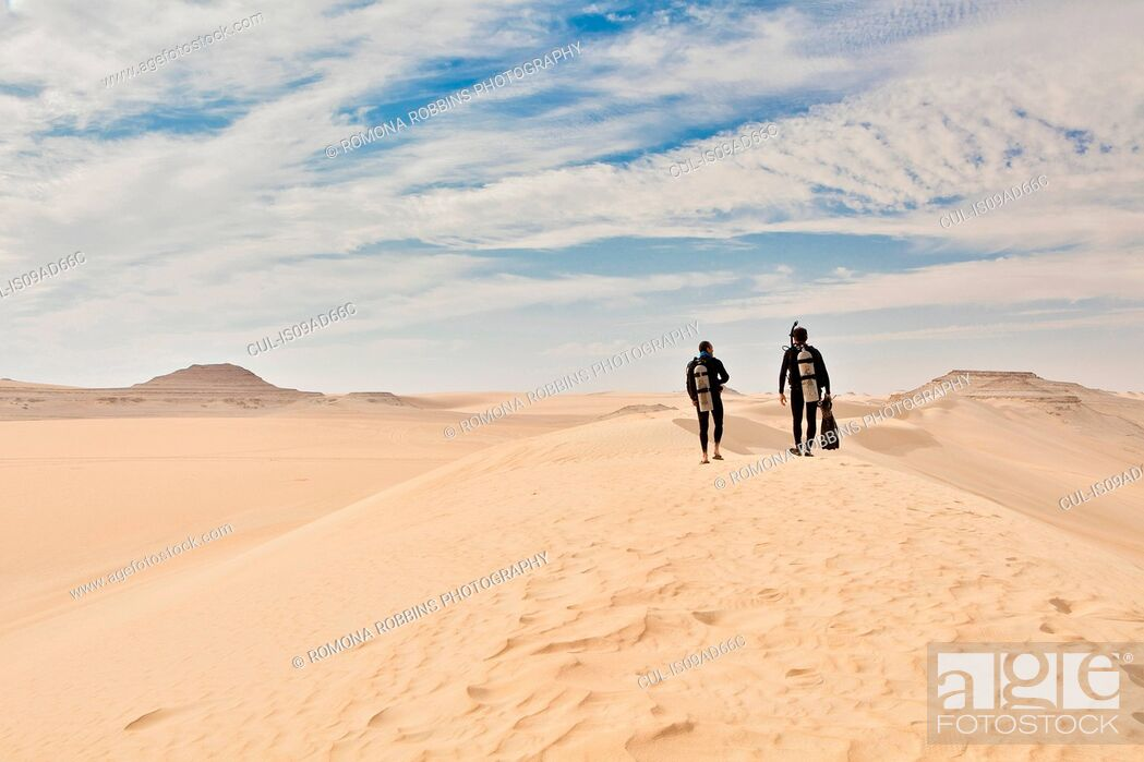 Stock Photo: Two men in wetsuits, Great Sand Sea, Sahara Desert, Egypt, Africa.