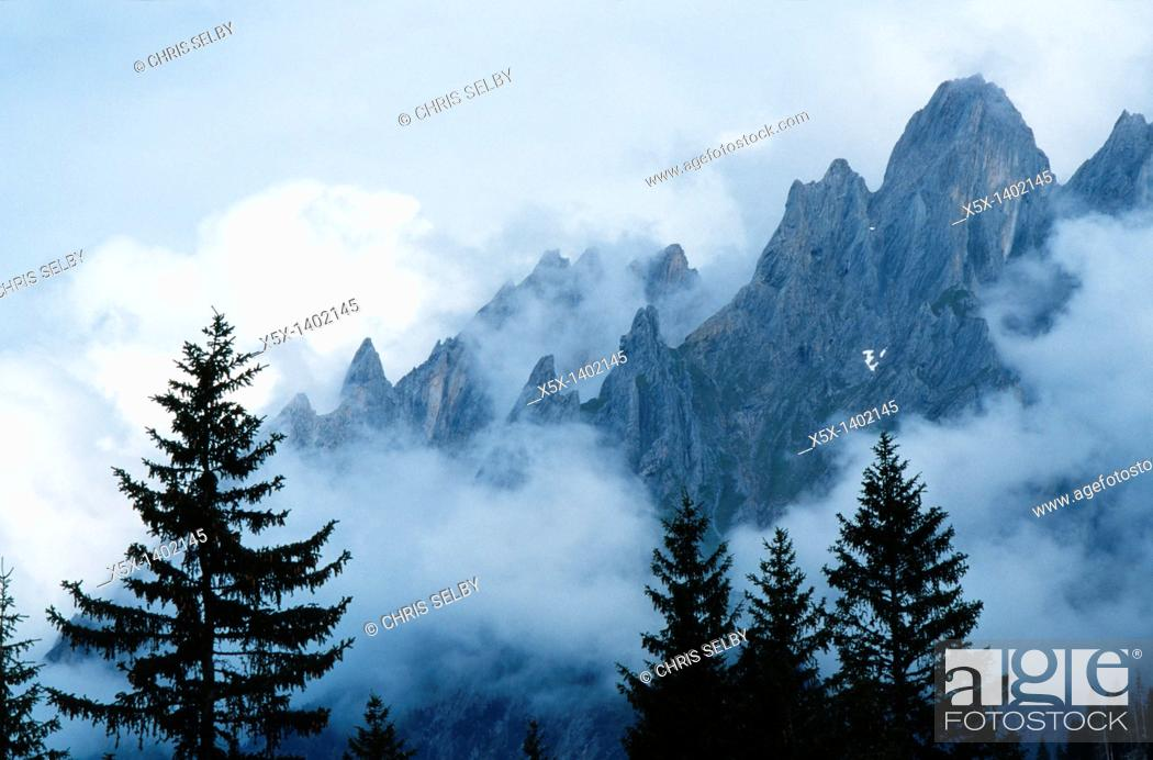 Stock Photo: Clouds hugging the Swiss Alps, Switzerland.