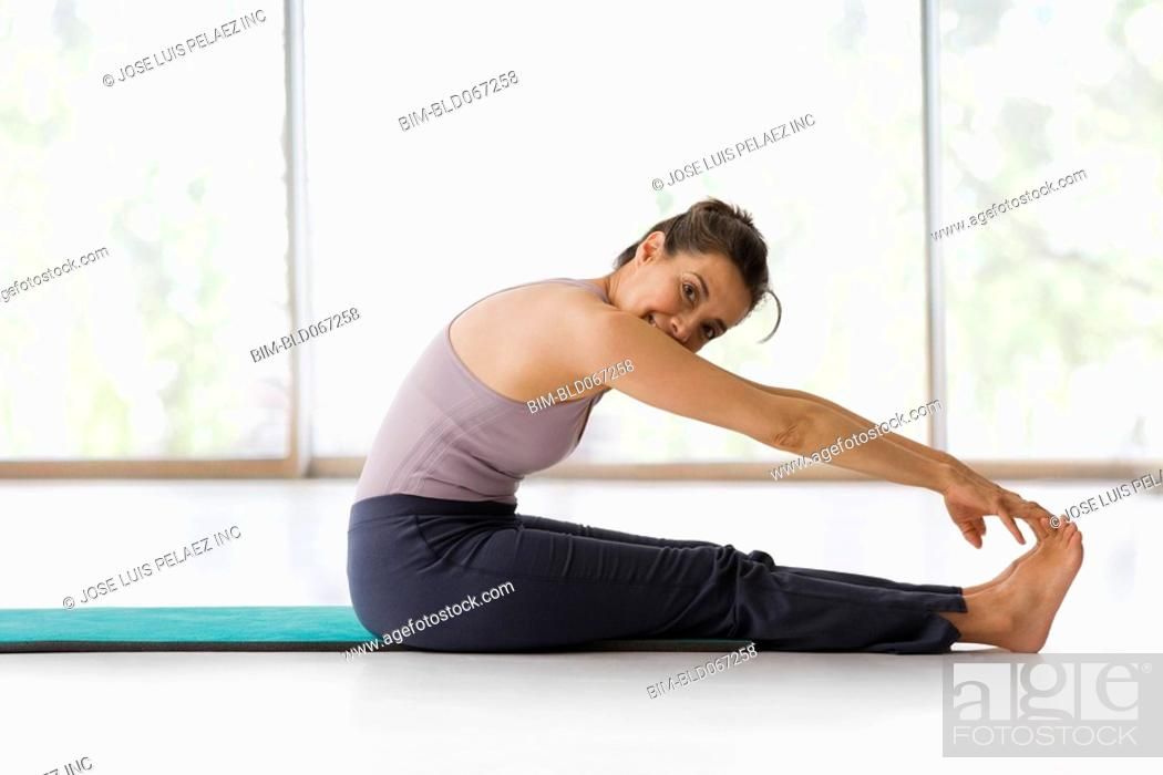 Stock Photo: Hispanic woman practicing yoga.