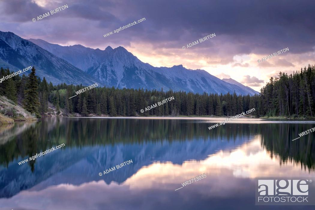 Stock Photo: Sunrise over the mountains of the Rockies, reflected in Johnson Lake, Banff National Park, UNESCO World Heritage Site, Alberta, Canada, North America.