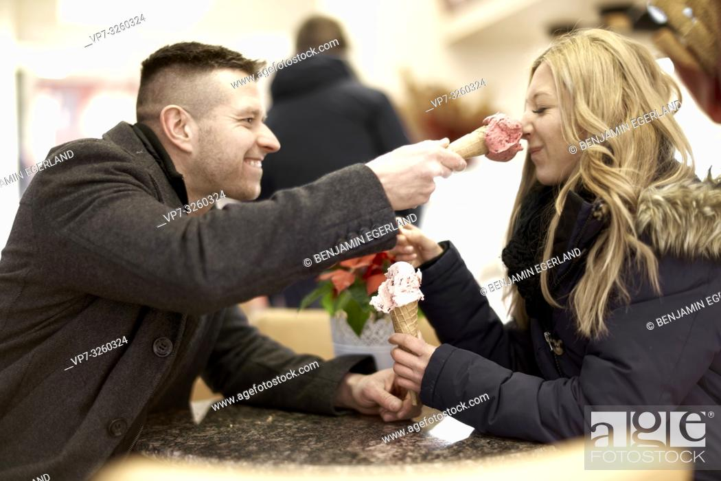 Photo de stock: playful couple eating ice cream in city Cottbus, Brandenburg, Germany.