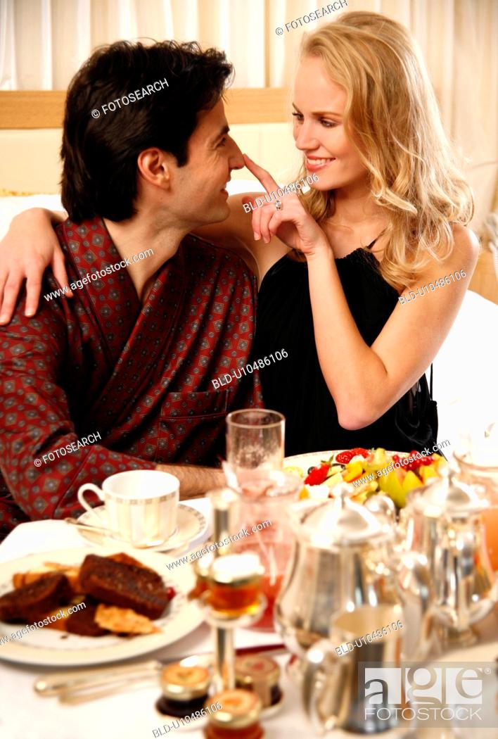Stock Photo: Couple having room service breakfast in hotel room.