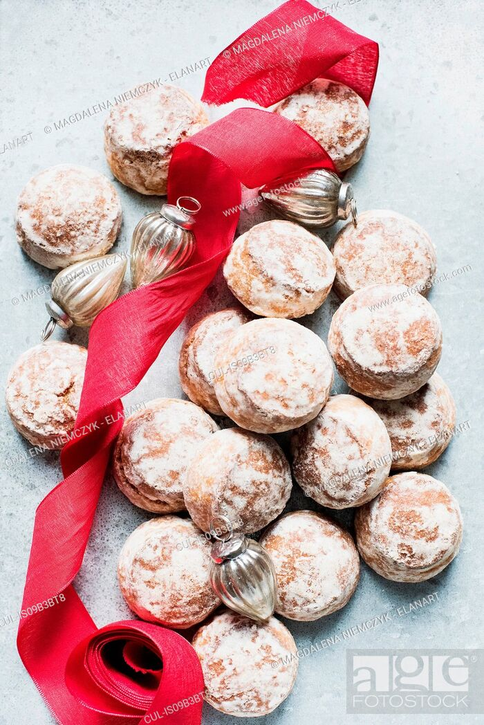 Stock Photo: Overhead view of Christmas baubles, red ribbon with fresh scones.