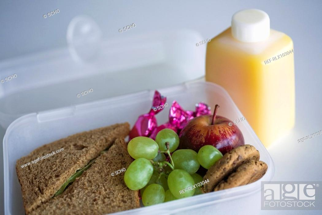 Stock Photo: School lunch box with sandwich, grapes and orange juice, close-up.