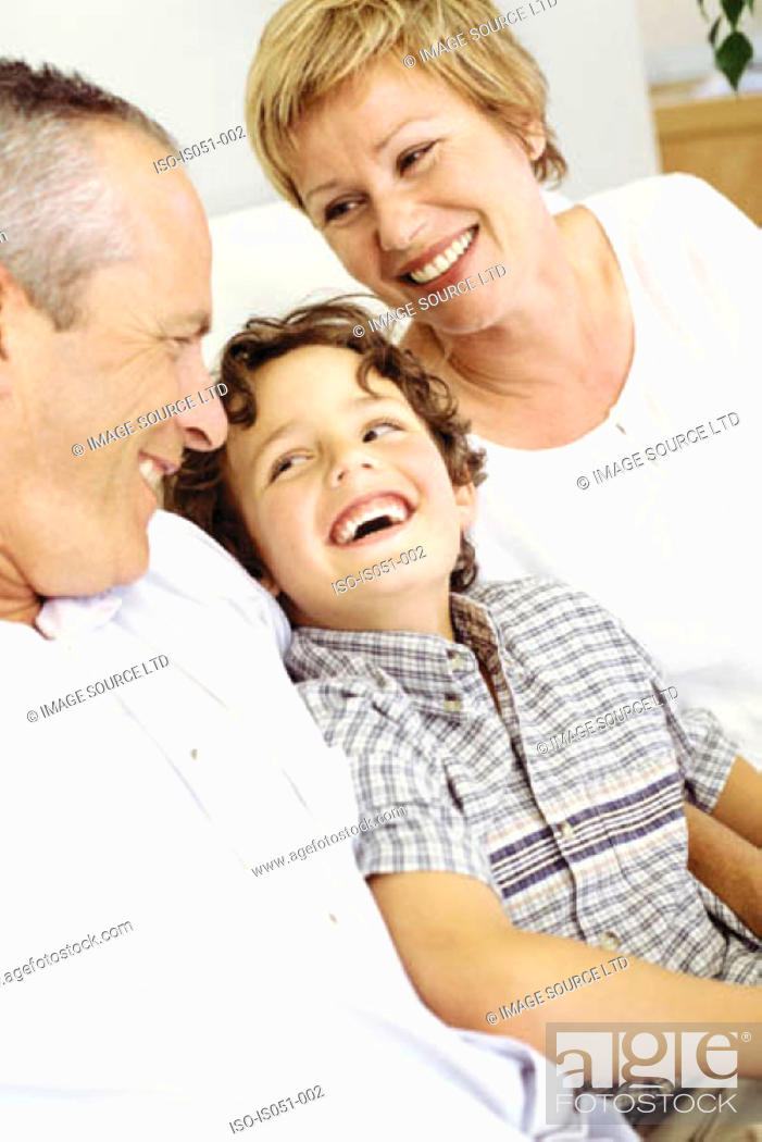 Stock Photo: Grandparents with grandson.