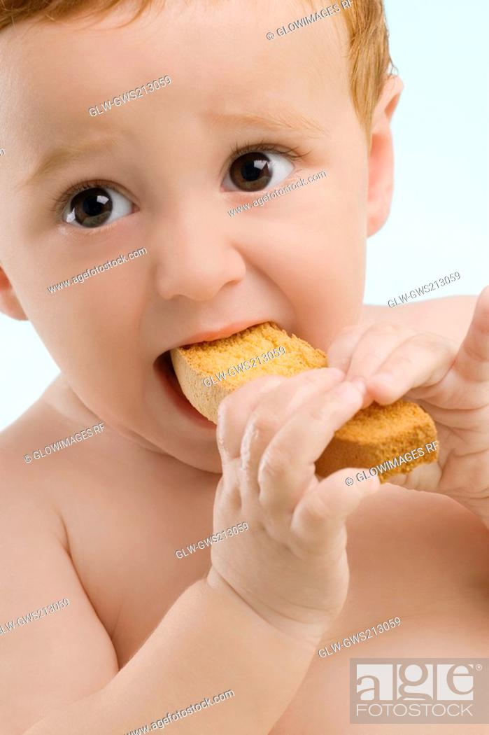 Stock Photo: Close-up of a boy eating a toast.