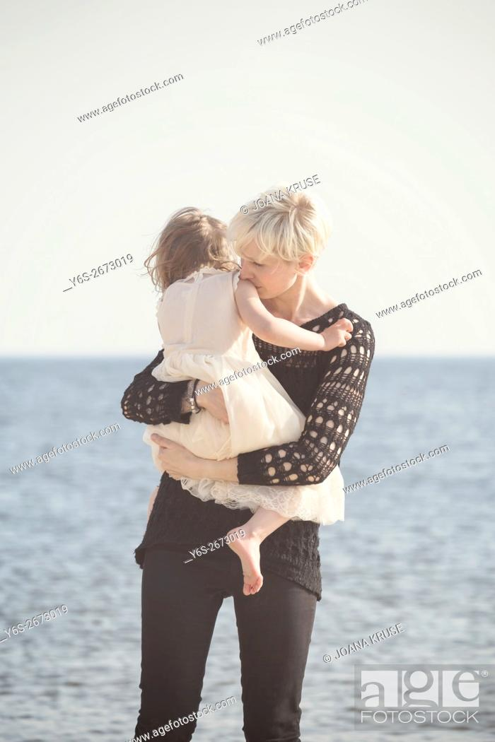 Stock Photo: mother and daughter at the sea.