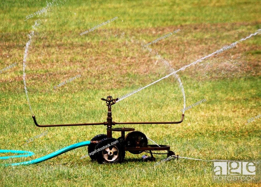 Stock Photo: Wasteful irrigation (evaporating).