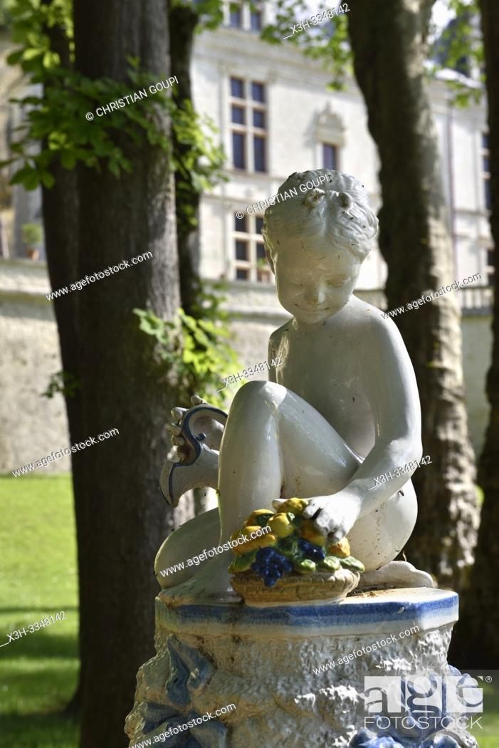 Stock Photo: little girl statue with jug and basket of fruit in the gardens of the Royal Domain of Chateau-Gaillard at Amboise, Touraine, department of Indre-et-Loire.
