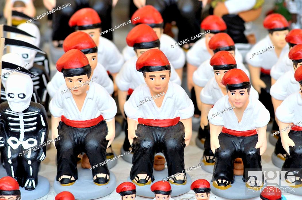 Stock Photo: 'Caganers', particular feature of modern nativity scenes at Santa Llucia Christmas fair, Barcelona. Catalonia, Spain.