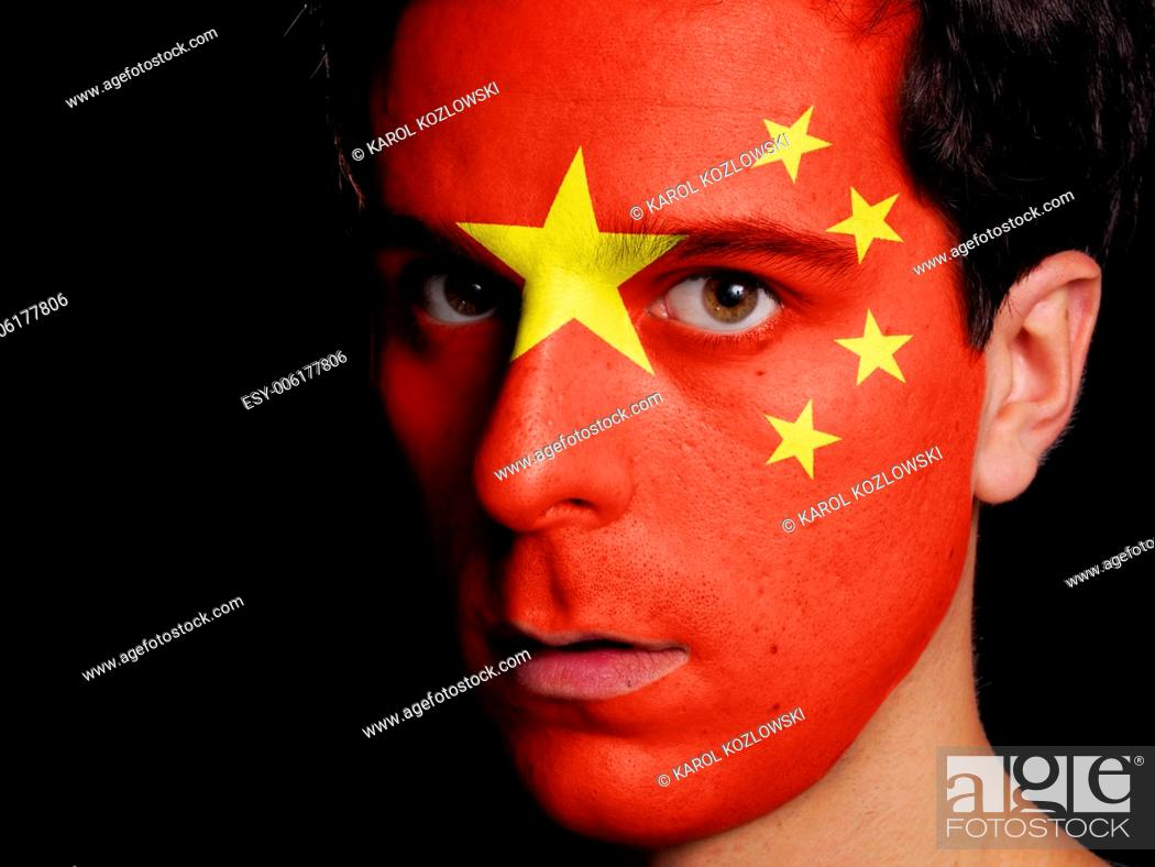 Stock Photo: Flag of China Painted on a Face of a Young Man.
