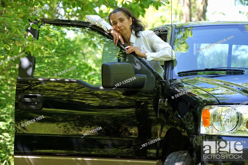 Stock Photo: Mature woman in pickup truck.