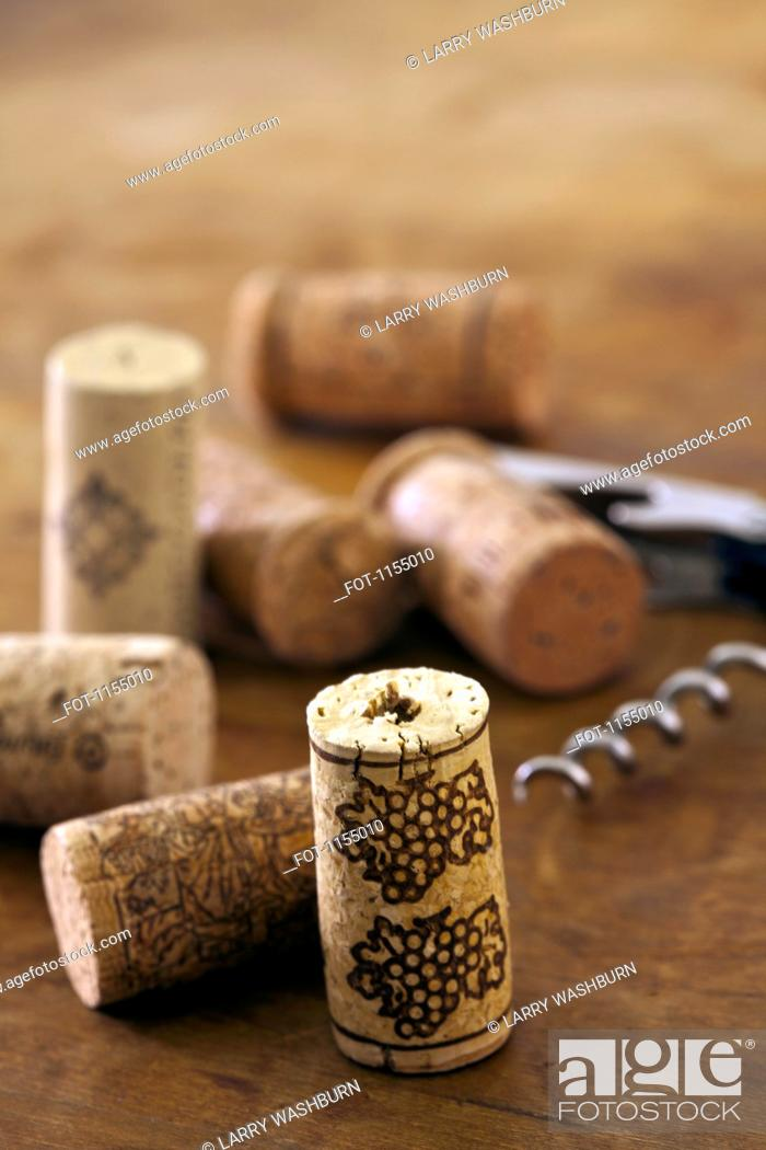 Stock Photo: Corks and corkscrew.