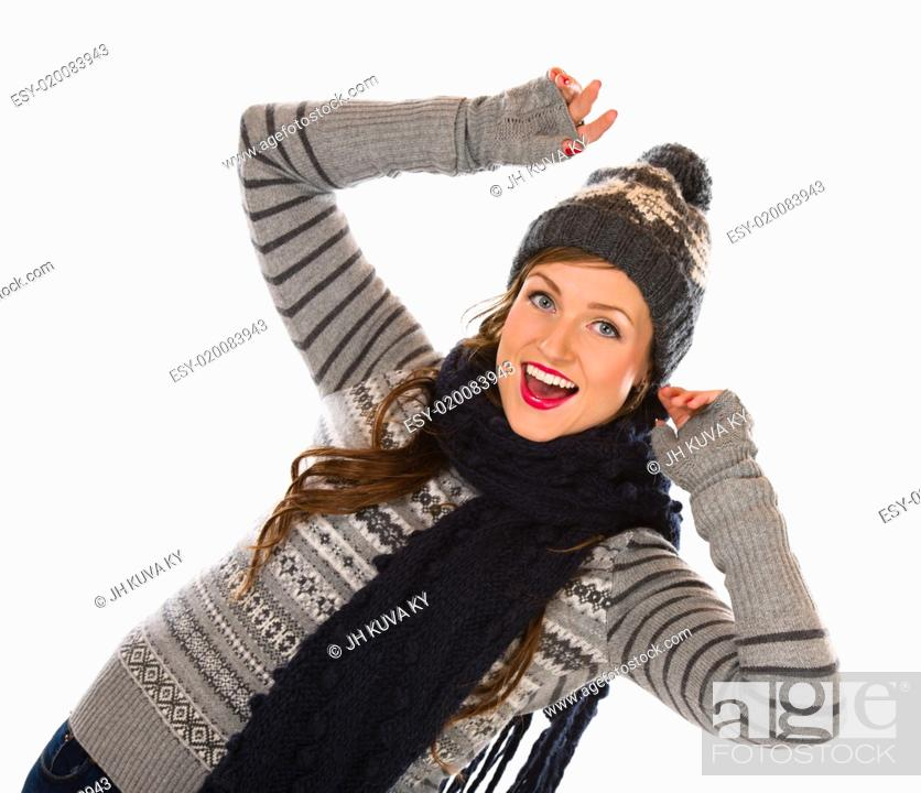 Stock Photo: Beautiful young woman wearing woolen outfit, white background.