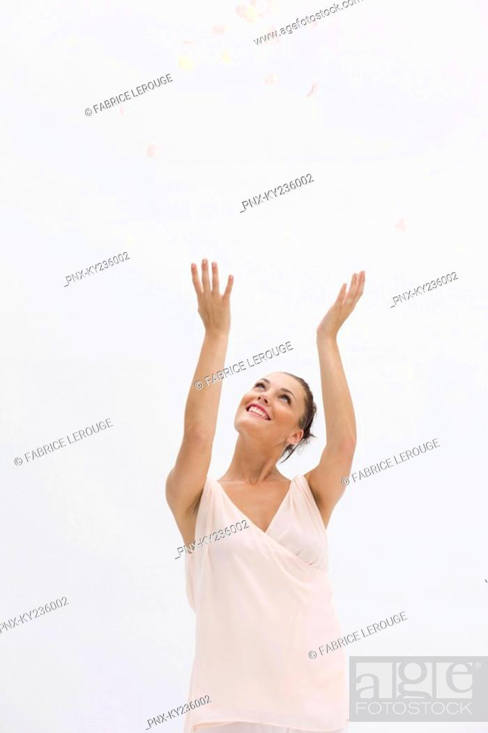 Stock Photo: Fashion model posing with her arms raised.