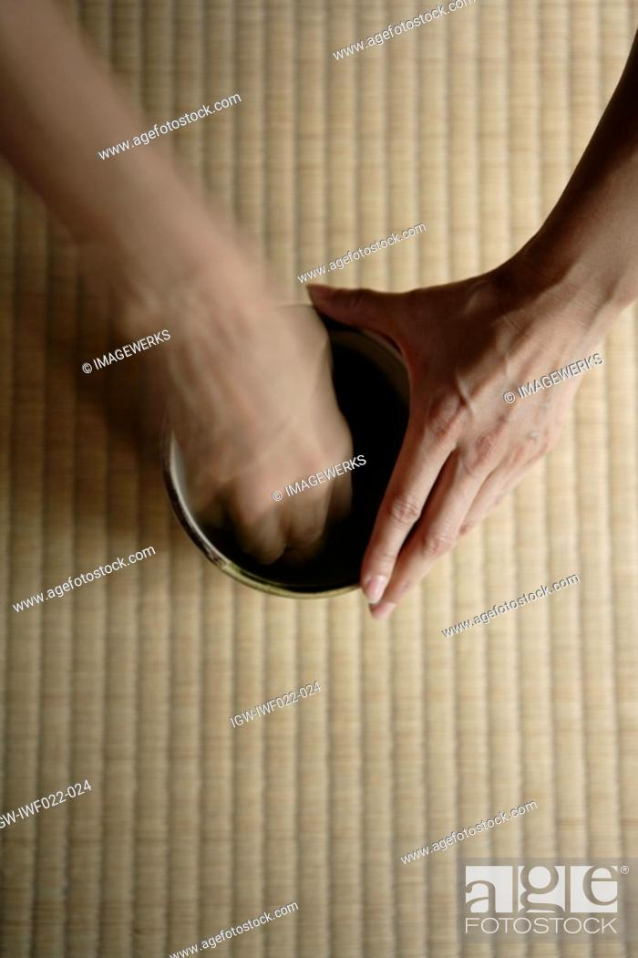 Stock Photo: View of a person grinding with hands.