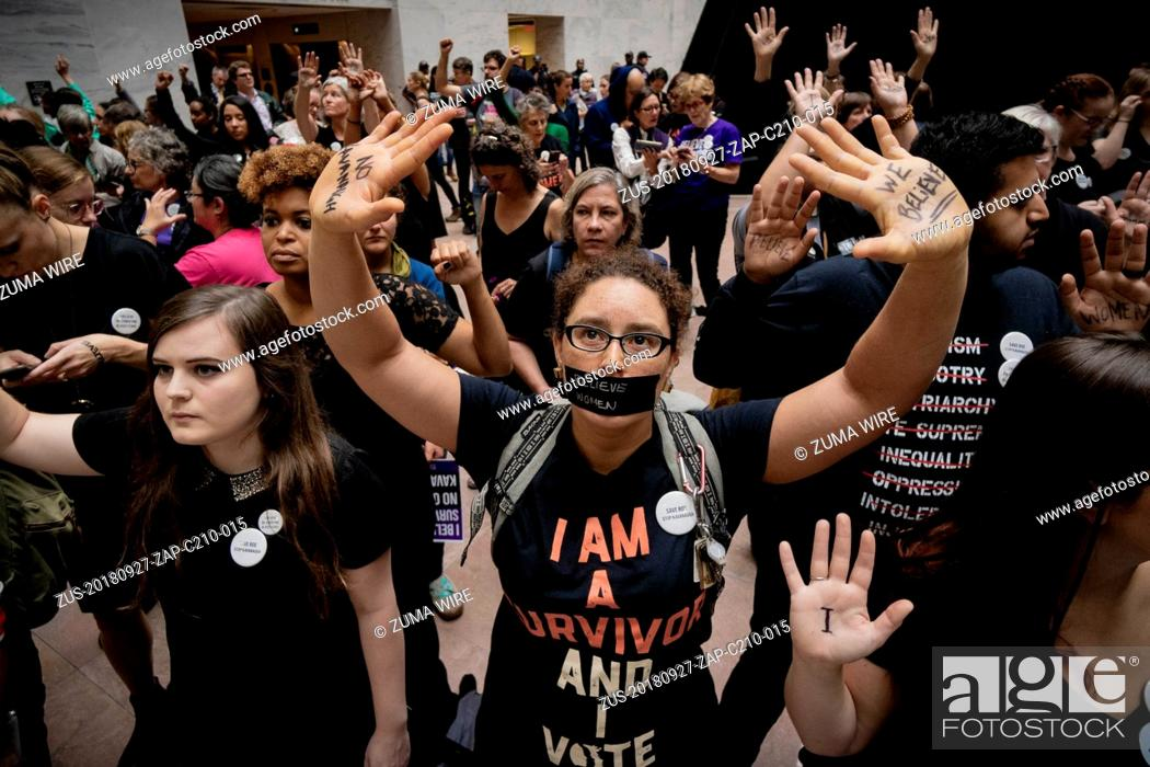 Stock Photo: September 27, 2018 - Washington, District of Columbia, United States - Protesters assembled in the foyer of the Hart Senate Office Building during the hearing.