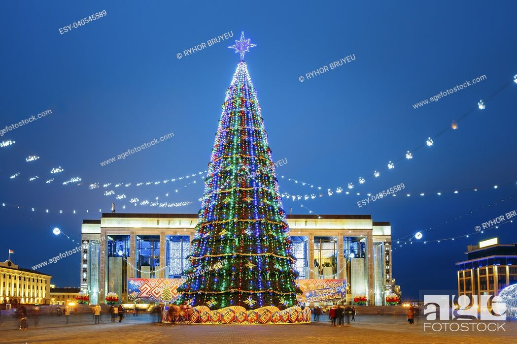 Stock Photo: Christmas tree, illuminations and decorations in front of building of the Palace of Republic in Oktyabrskaya Square - famous place in central Minsk, Belarus.