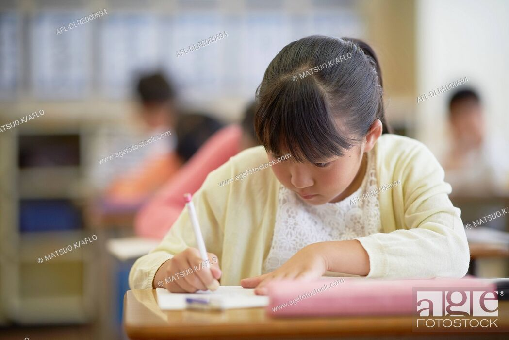Stock Photo: Japanese elementary school kid in the classroom.